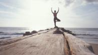 woman doing yoga peacfully outside